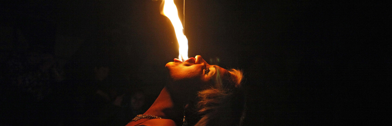 "In this July 7, 2013 photo, drag queen Susan Brown spits fire during her performance in the ""Fama"" circus show in Santiago, Chile.  The only classic circus act in Fama is Brown's fire eating performance.  Fama has toured the country for more than a decade performing in modest tents and they say their show remains a refuge from discrimination. Chile has traditionally been a tough place for homosexuals. (AP Photo/Luis Hidalgo)"